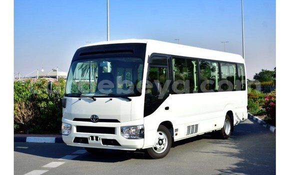 Medium with watermark toyota coaster ethiopia import dubai 6077
